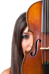 Young girl with violin against white background.