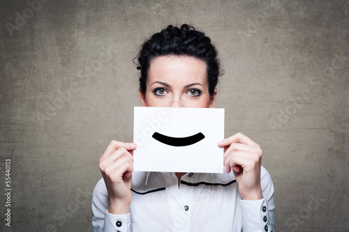 Young businesswoman hiding his face with a white billboard