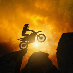 Motorcircle rider in rocks