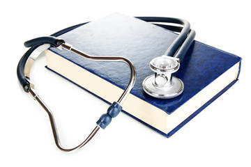 Medicine law concept. Stethoscope on law book isolated on white