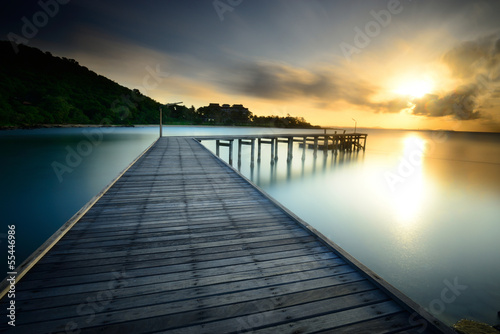 The wooden bridge with sunrise at national park Khao Leam Ya - M