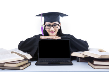 Happy graduate student with copyspace on laptop
