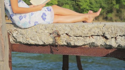 Attractive Woman Sitting on Pier Reading Book Holiday Concept HD