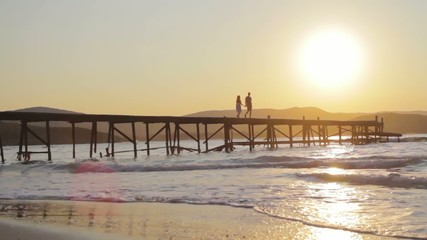 Love Concept Couple at Sunset Walking Pier Beach Holiday HD