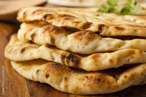 Staande foto Brood Homemade Indian Naan Flatbread