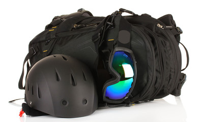 Winter sport glasses, helmet and gloves, backpack, isolated
