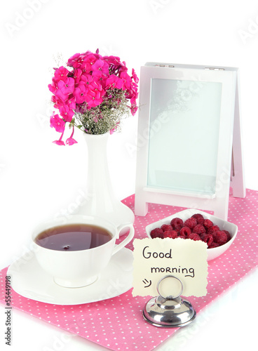 Beautiful bouquet of phlox with cup of tea isolated on white
