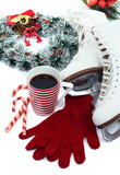Figure skates with cup of coffee isolated on white