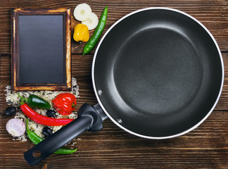 rice with vegetables next to a frying pan