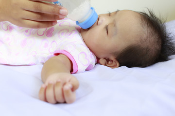 Baby drink milk and sleep