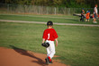 Little league player walking