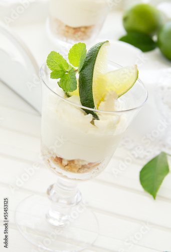 Cheesecake with lime in a glass. Selective focus.