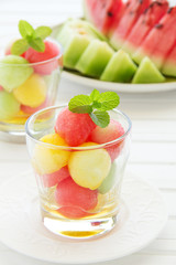 The dessert salad of watermelon and cantaloupe with honey.