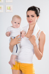 Mother after fitness exercises with her baby
