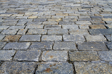 Spotted cobblestone background in perspective