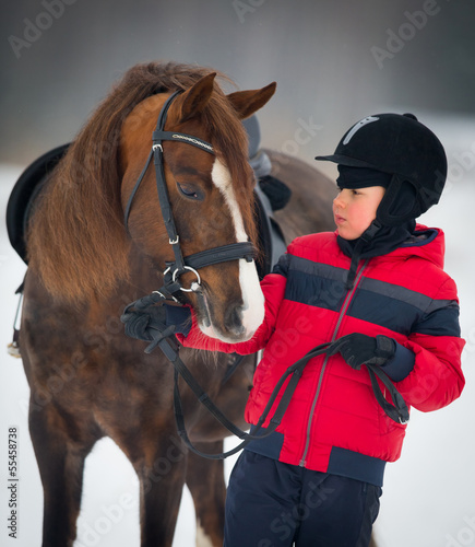 Horse and boy - child riding horseback