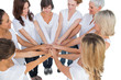 Peaceful female models joining hands in a circle