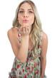 Seductive blonde wearing flowered dress sending a kiss