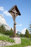 crucifix in the mountains at cortina d'ampezzo