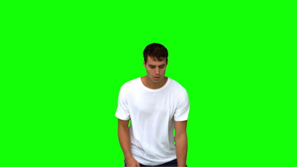 Man catching and throwing a basketball on green screen