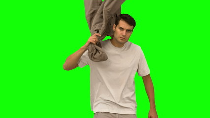 Handsome man holding his coat on green screen