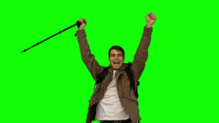 Happy man throwing his hat on green screen