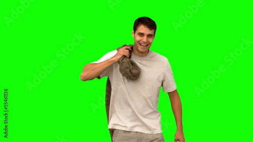 Man holding his coat on green screen