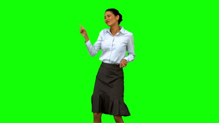 Businesswoman disco dancing on green screen