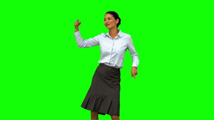 Cheerful businesswoman disco dancing on green screen