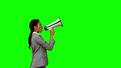 Businesswoman shouting into a megaphone on green screen