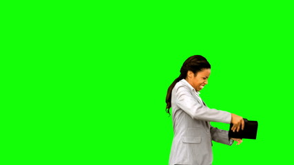 Angry businesswoman throwing her agenda on green screen