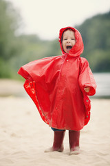 little funny girl with raincoat
