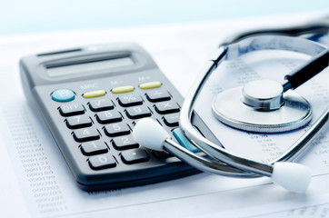 Stethoscope and calculator symbol for health care costs