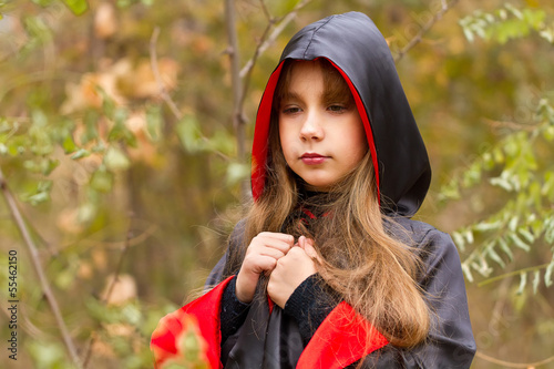 girl in a red and black cloak