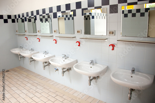 row of washbasins in building of camping in italy