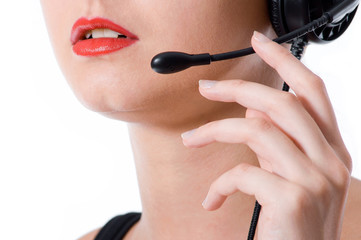 Close-up shot of a hotline worker speaking into a microphone