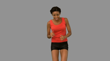 Woman jogging on grey screen