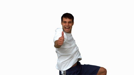 Handsome man giving thumbs up on white screen