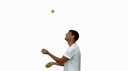 Man dribbling with balls on white screen