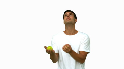 Handsome man dribbling with balls on white screen