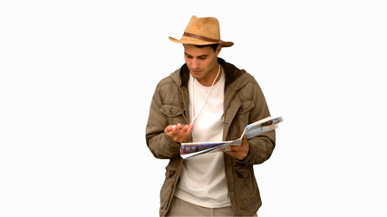 Man with a map and a compass orienteering on white screen