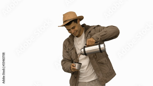 Man pouring coffee from a vacuum flask on white screen
