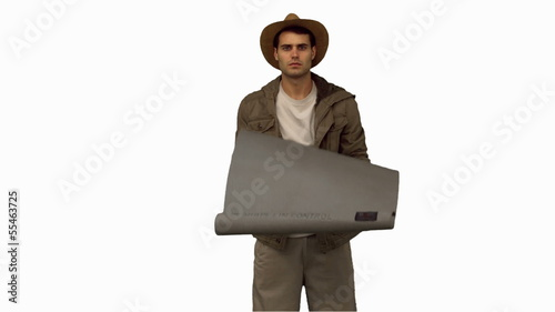 Man rolling out a sleeping bag on white screen