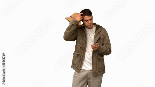 Lost man using his compass on white screen