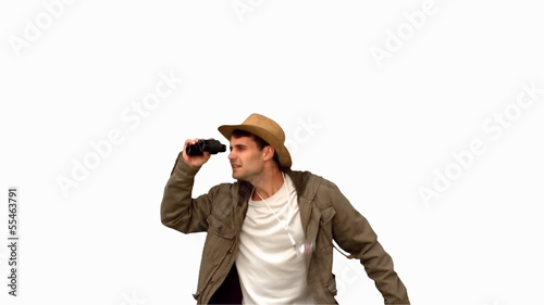 Man jumping and using binoculars on white screen