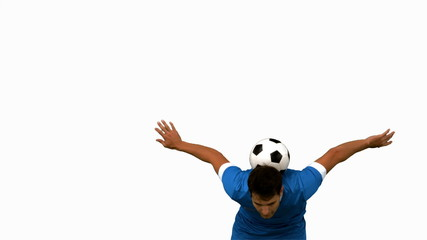 Man juggling a football with head on white screen