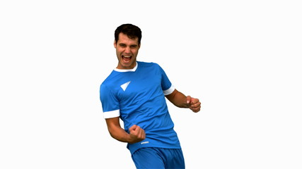 Cheerful football player gesturing on white screen in slow mo