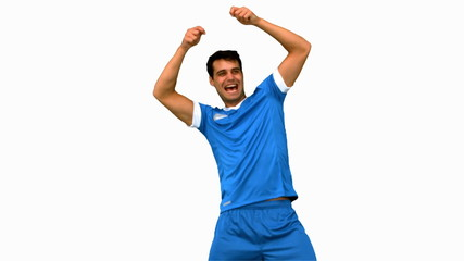 Happy football player gesturing after a goal on white screen