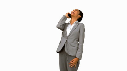 Businesswoman laughing while phoning on white screen