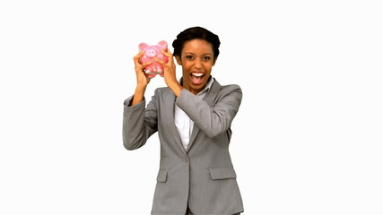 Businesswoman listening to a full piggy bank on white screen